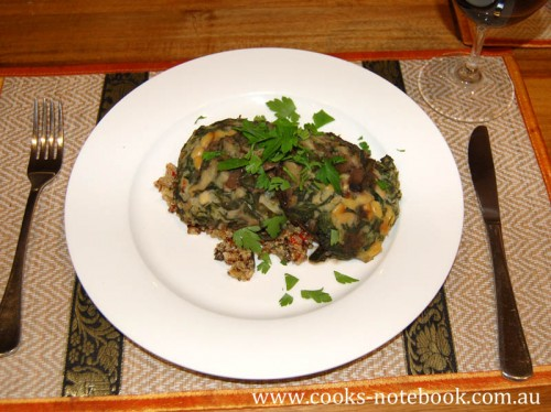 Spinach and pine nut stuffed field mushrooms with tri-coloured quinoa